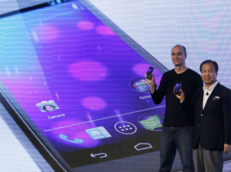 Google's top mobile executive Andy Rubin,and JK Shin, president and head of mobile communications business from Samsung, hold the new Galaxy Nexus smartphone during the news conference in Hong Kong.