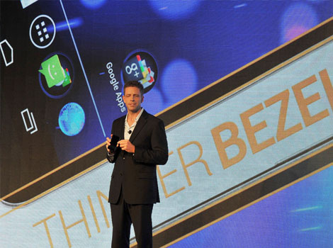 "Kevin Packingham, Samsung's senior VP of product innovation holds the Galaxy Nexus. Samsung Electronics unveiled its new smartphone running on ""Ice Cream Sandwich"", Google's latest Android  OS, stepping up the challenge on Apple's iPhone."