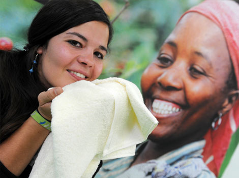 "A woman holds a cotton towel produced in Africa in Dortmund, western Germany, during the ""Fair 2011"" an exhibition for fair trade."