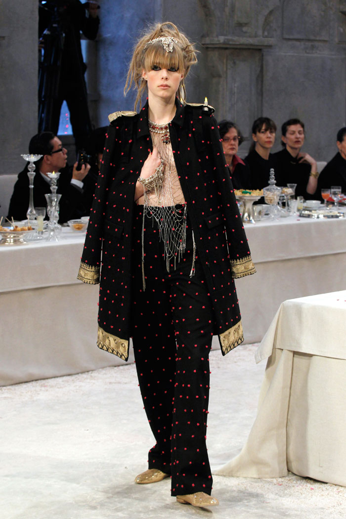 There was no sign of the economic downturn at the Chanel's Indian themed pre-fall collection, titled Paris-Bombay. Chanel chief Karl Lagerfeld, who certainly knows how to put on a show, transformed the runway into an aisle flanked by banquet tables laden with food and candles. The outfits were fit for royalty.