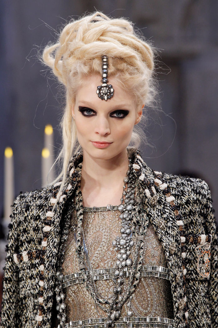 Chanel's trademark tweed and pearls also made appearances throughout the collection.