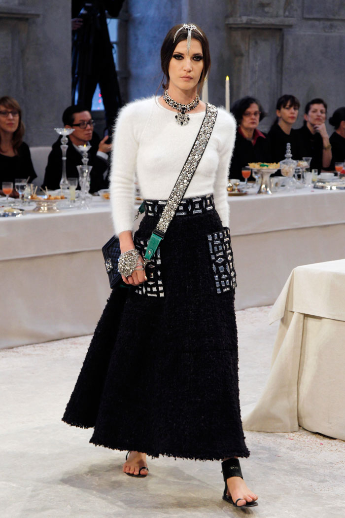 A cosy knit and flowing skirt are kept interesting with the sideslung bag's sequined strap.